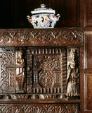 Detail of Charles I court cupboard which has been extensively recarved in the c19th and restored in the 1940's when a quartering of the Ferrers-Walker arms was set into the frieze