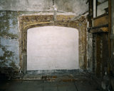 Blocked up 16th-century fireplace at Sutton House in the Presidents/ Exhibition room