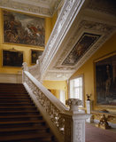 View from the ground floor up the Grand Staircase showing the elaborate carved balustrade by Edward Pierce, the plasterwork on the underside by James Pettifer &amp; the paintings