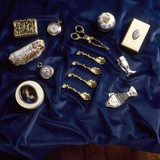 Close-up of items on display in a showcase in the Drawing Room
