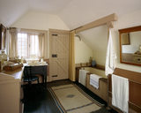 The Servants' Bathroom in the Tower at Wightwick Manor looking towards the bath