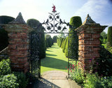 A view through the gateway at Packwood House of the yew garden based on the Sermon on the Mount