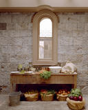 Vegetable Scullery showing vegetables ready for preparation, on the wooden table