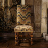 Close-up of late 17th century Italian chair with bargello or flamestitch needlework in the Long Gallery at Packwood House