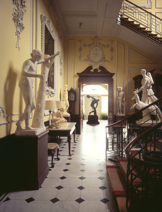 View through the Staircase Hall to the Garden Room at Hatchlands, The Hall is home to several statues, most of which are plaster casts of classical subjects