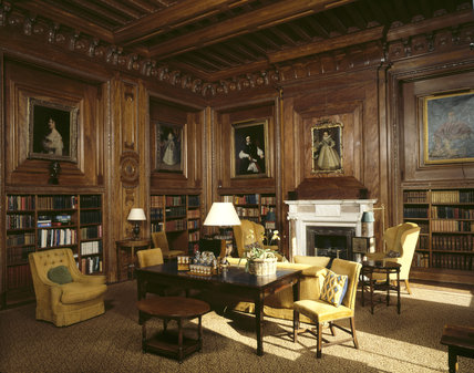 The Panelled Library With Portraits And Gold Coloured
