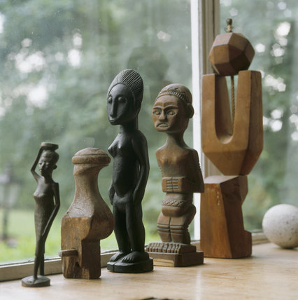 A collection of African/modern sculptures on the window sill at 2 Willow Road
