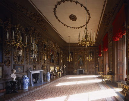 The Carved Room at Petworth with the four paintings by Turner restored to the panelling, looking South