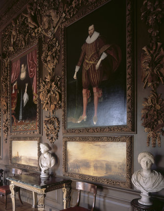 The Carved Room at Petworth showing a partial view of the East Wall showing the carvings and two paintings by Turner restored to the panelling, looking north
