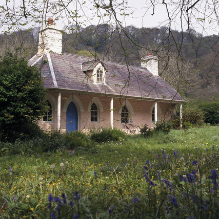 The charming C18th Estate Office at Llanerchaeron, set in a field of bluebells
