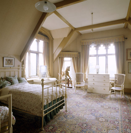 The night nursery on the second floor at Tyntesfield showing a bed, rocking horse, chest of drawers and turret room