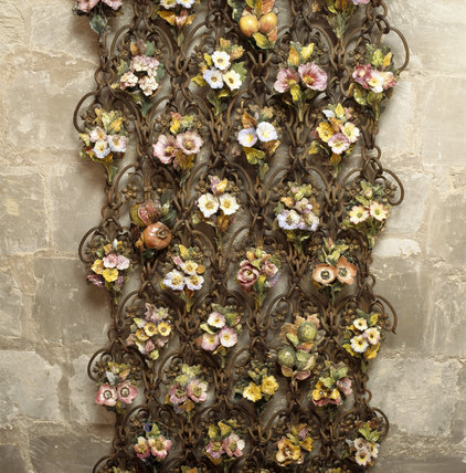 The north Italian chain-link screen decorated with ceramic fruit and flowers in the South Porch attests to Lord Fairhaven's love of craftsmanship and gardening