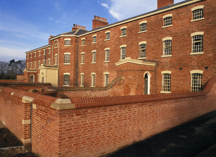 Oblique view of the front facade of the workhouse, showing the wall round the exercise yard