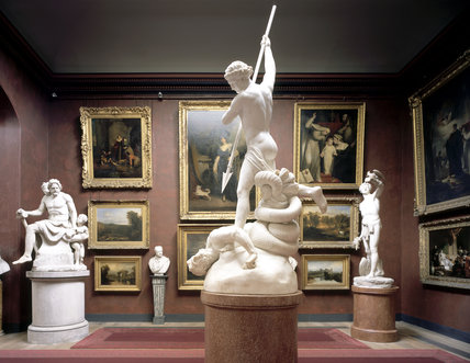 The North Gallery at Petworth, showing the North Bay, with Flaxman's St Michael Overcoming Satan, completed 1826