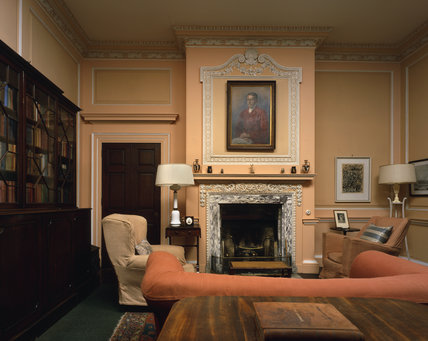 Library with C18th mahogany break-front bookcase & fireplace