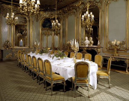 The French Dining Room with Rococo 'boiseries' panelling & marble chimney-piece from the Chateau d'Asnieres, near Paris