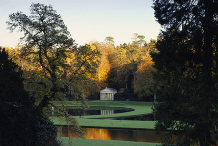 Studley Royal Water Garden in autumn with Classical building,the Temple of Piety added by John Aislabie, a garden house with new stucco decoration by Giuseppe Cortese in the late 1740s