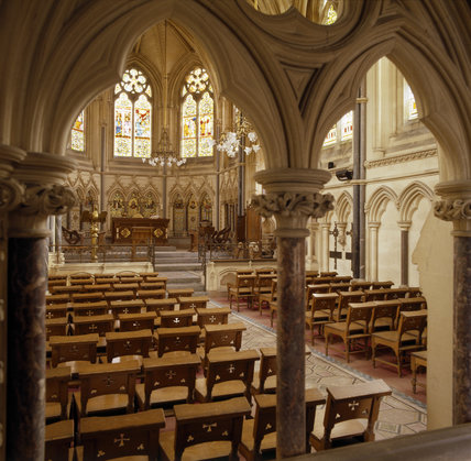 Interior of Chapel has ornately carved stone walls and a high vaulted carved stone ceiling