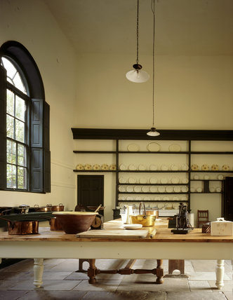 Great Kitchen showing large arched window & the plate-shelves