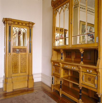 Close view of a cupboard and jewellery safe with decorated mirrored glass doors in Gothic style
