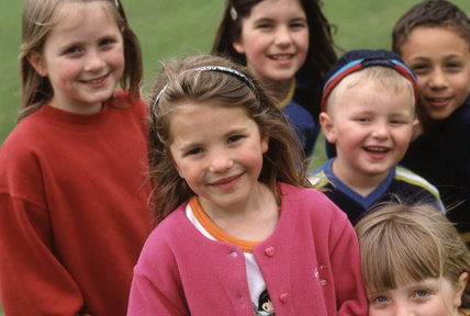An informal portrait of a group of young children taken in the grounds of Polesden Lacey. MR