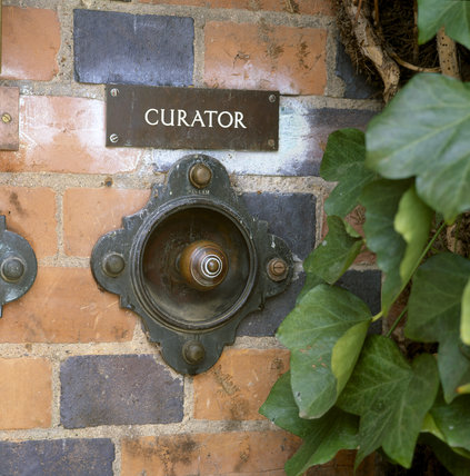 Doorbell and sign for Curator on outside wall at Sudbury Hall