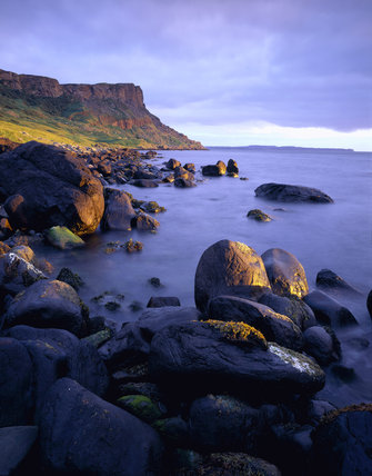 Fairhead, taken from Drumnakill Point, with Rathlin Island beyond, in the dawn sunlight.