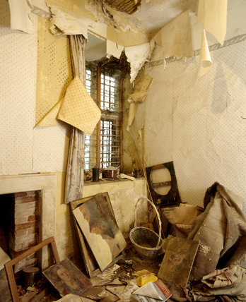Heavily peeling wallpaper in a room at Chastleton House, showing damage