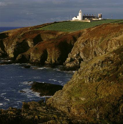 Lizard Lighthouse, Bumble Rock and dawn sun