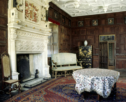 Room view of the Great Chamber including the chimneypiece which bears the arms of Walter Jones impaling those of Pope