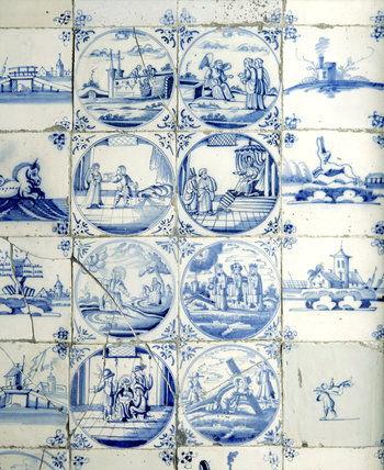 Close-up details of ceramic tiles in fireplace in the Great Parlour at Chastleton House