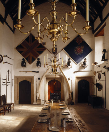 Room view of the Hall showing the arch-braced timbers of the roof, two large flags of the 4th (Royal South Middlesex) Militia, which date from the time of the Napoleonic Wars