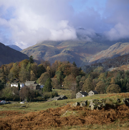 Elterwater Village with cloud shrouded Langdale Pikes beyond