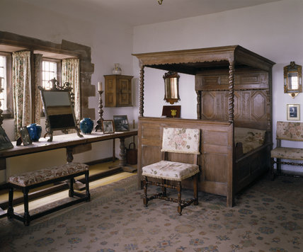The East or Master Bedroom, containing a Flemish four poster bed ( dated 1753 ) and a long refectory table