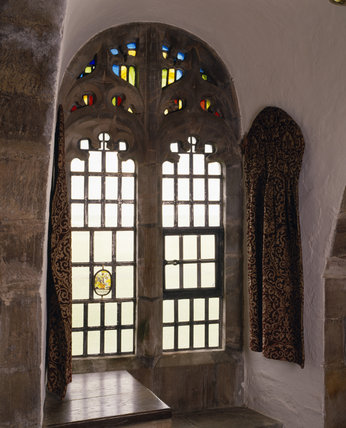 A close-up view of the neo-gothic traceried window and curtain, introduced by Lutyens