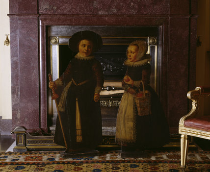 A pair of early 18th century painted dummy-boards in the Entrance Hall at Hinton Ampner