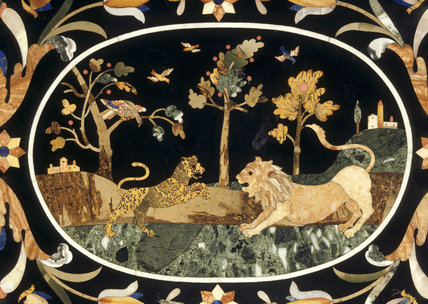 An 18th century Florentine Pietra Dura table top in the Bust Parlour at Shugborough Hall showing a lion and a leopard with landscape behind