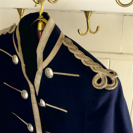 Close-up of footman's jacket on display at Lanhydrock