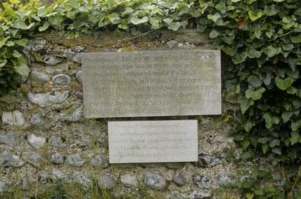 Two memorial plaques dedicated to Virginia and Leonard Woolf on the wall in the garden at Monk's House