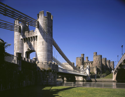 A side view of Conwy Suspension Bridge towards the castle from below