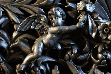 Carving of a cherub, part of the Chales Wade collection at Snowshill Manor, Gloucestershire