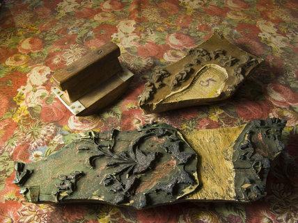 Close view of hand blocks and printed fabric at Quarry Bank Mill, Styal