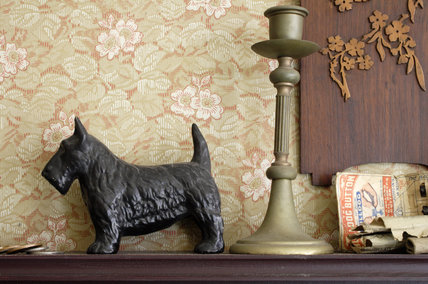 A candlestick and ornament on the mantlepiece of the front parlour of the 1930s house in the Birmingham Back to Backs