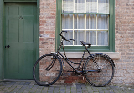 A bicycle leaning against the wall of the Courtyard, Court 15, Birmingham Back to Backs