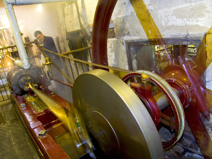 Close view of the mechanism of the Horizontal Engine used to provide steam power at Quarry Bank Mill, Styal, a cotton-spinning mill established in 1784