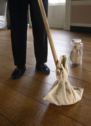 Paraffin and vinegar cloth (stored in airtight jar) tied around cotton head of long flat dust mop and being used to dust and buff floorboards in the Long Gallery at Osterley Park