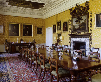 The Dining Room at Hanbury Hall  with mahogany dining table and chairs   Rococo chimneypiece and overmantel  and part of the painted ceiling by  James. The Dining Room at Hanbury Hall  with mahogany dining table and