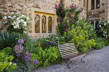 Garden Bench Under A Mullioned Window On The East Front At