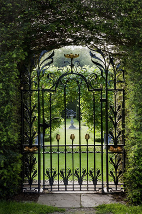 View Through A Decorative Wrought Iron Gate Into The