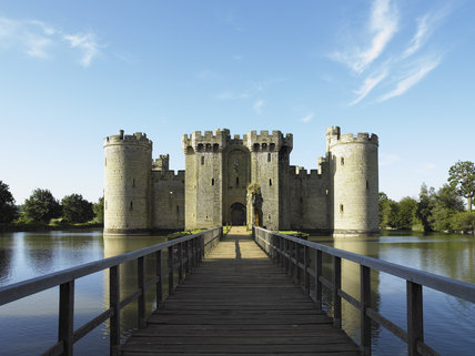 A long view down the bridge towards the Gatehouse and North Range at Bodiam Castle, East Sussex, built between 1385 and 1388